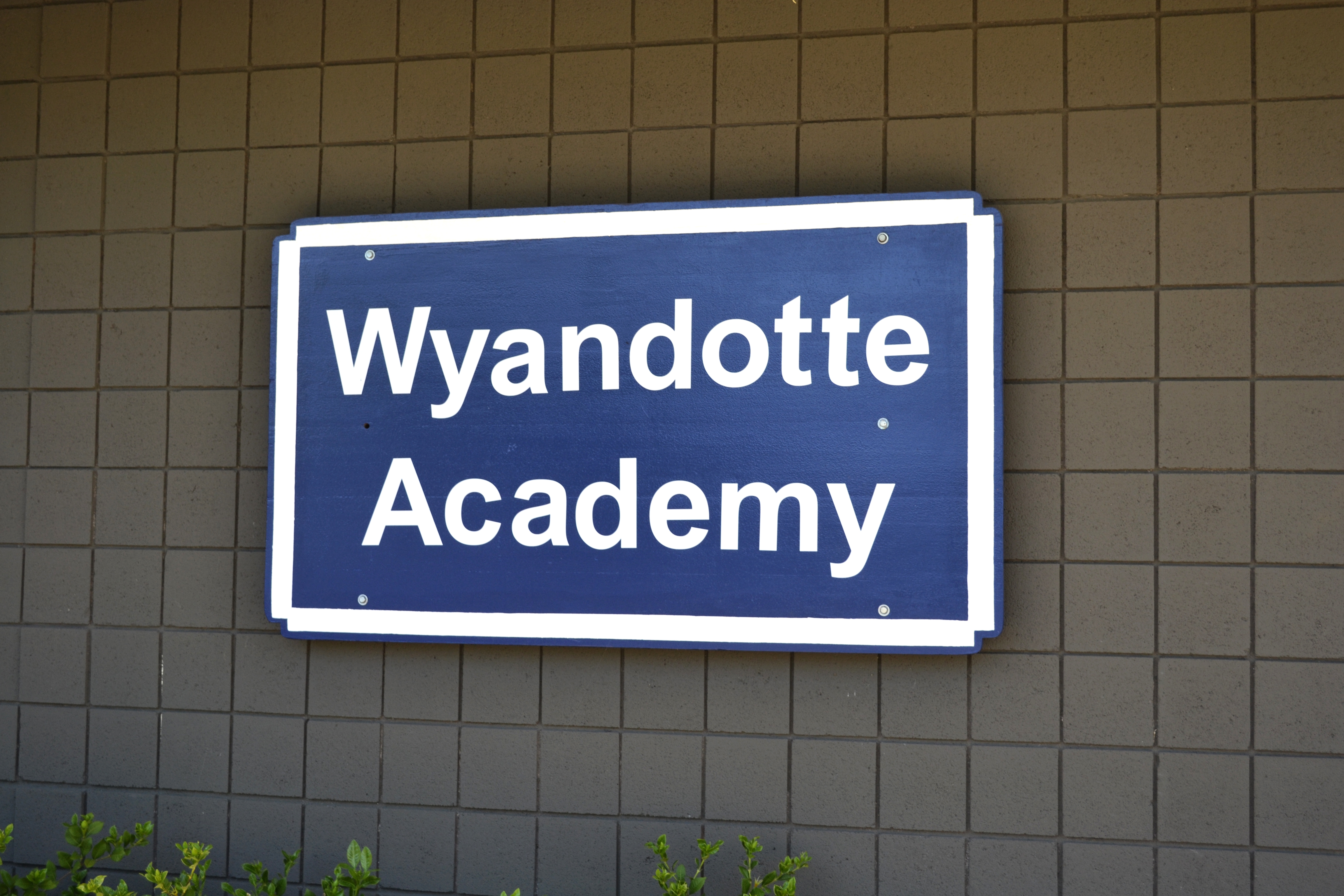 Sign on the front of the WA building